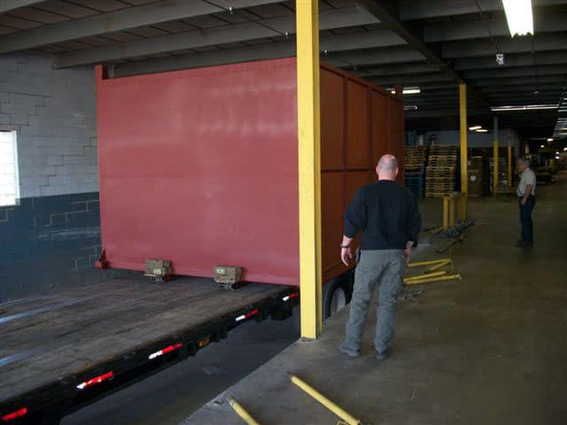 Hampton Industrial Services crew rigging and moving corrugated machinery